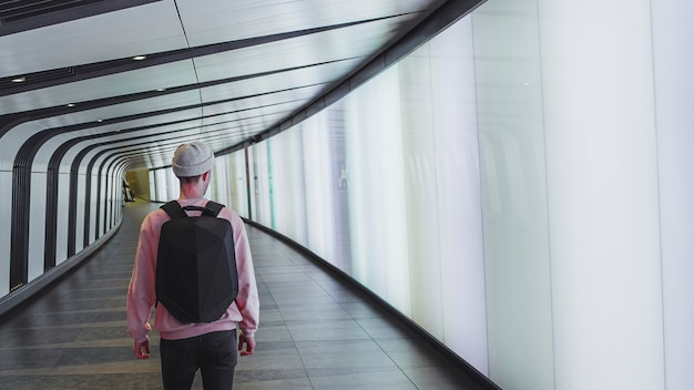 Man walking through the kings cross tunnel