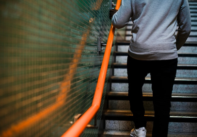 Man walking up some stairs
