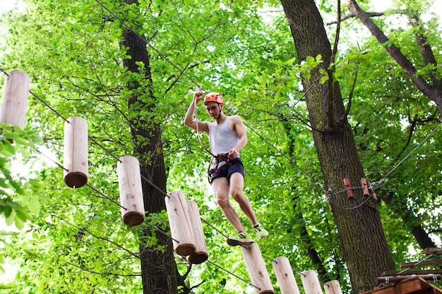 Man walks on the rope path in the air
