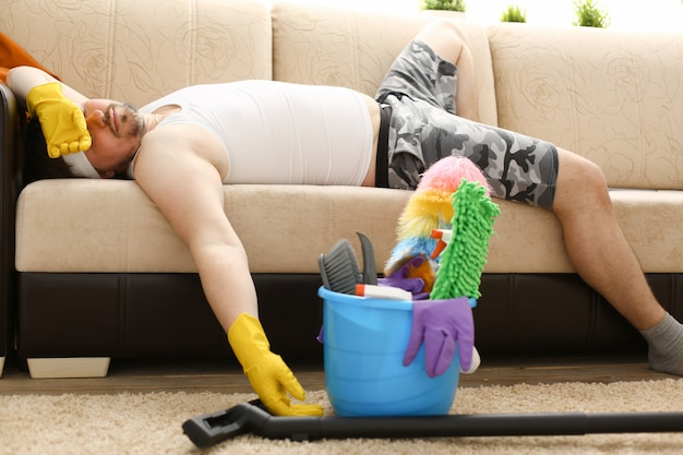 The man was left alone at home tired of cleaning and fell asleep