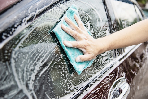 Man wash car using shampoo