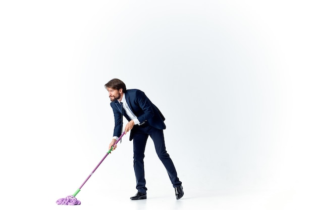 Man washes the floors with a mop manager office work service