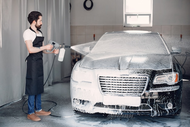 Man washing his car in a garage