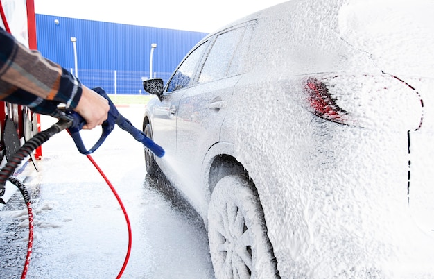The man washing his car on self-service car wash