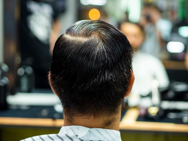 Man watching himself in blurred mirror