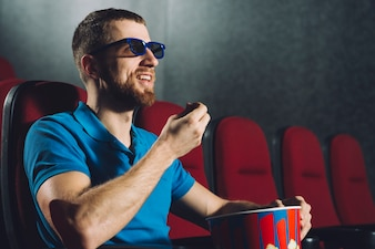 Man watching interesting movie in cinema