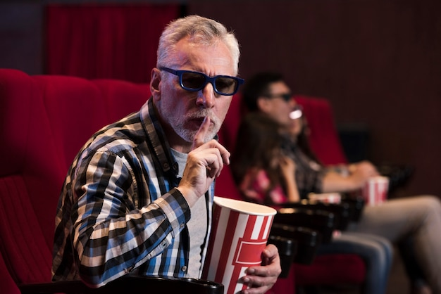 Man watching movie in cinema