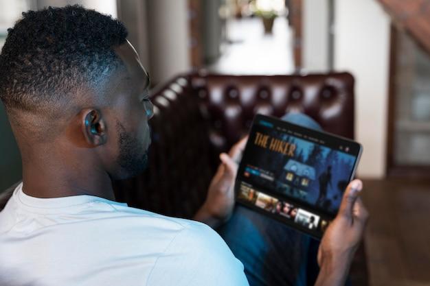 Man watching a movie on netflix