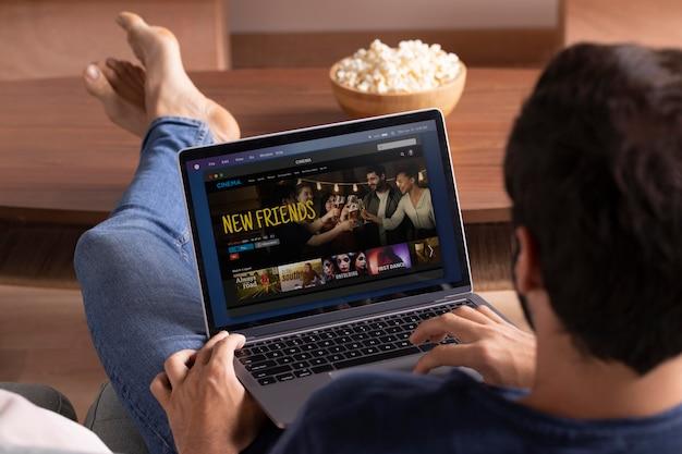 Man watching netflix on his laptop