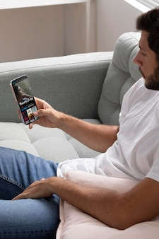 Man watching netflix on his smartphone