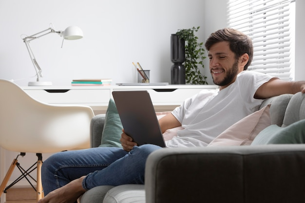 Man watching netflix on his tablet
