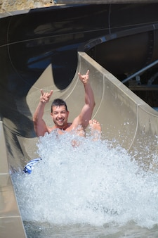 Man in a water slide