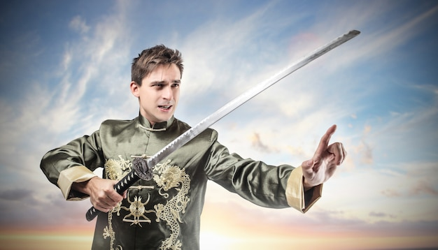 Man wearing antique costume and a sword