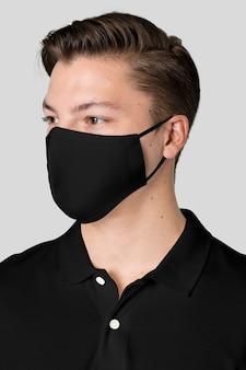 Uomo che indossa una maschera in tessuto nero per la campagna di protezione covid-19