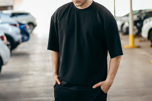 Man wearing black tshirt on a parking background