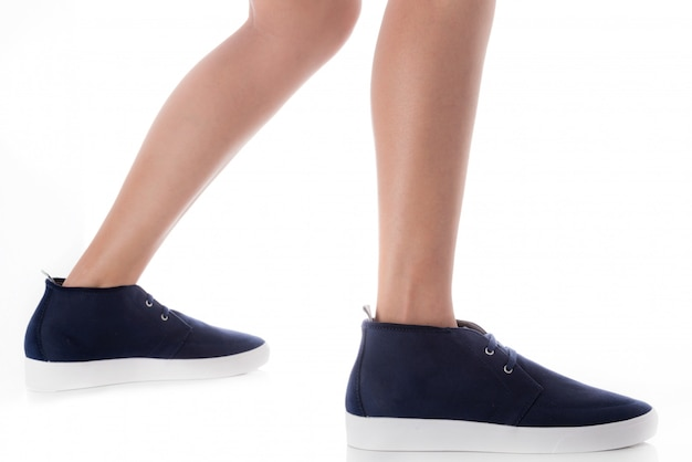 Man wearing blue fashion footwear stepping with side profile view isolated on white