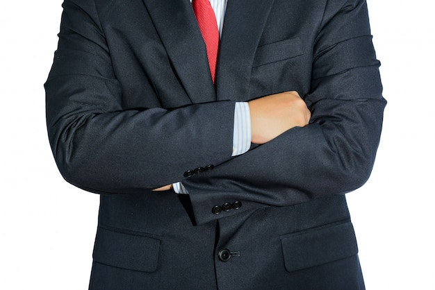Man wearing business suit and black tie with arms crossed isolated