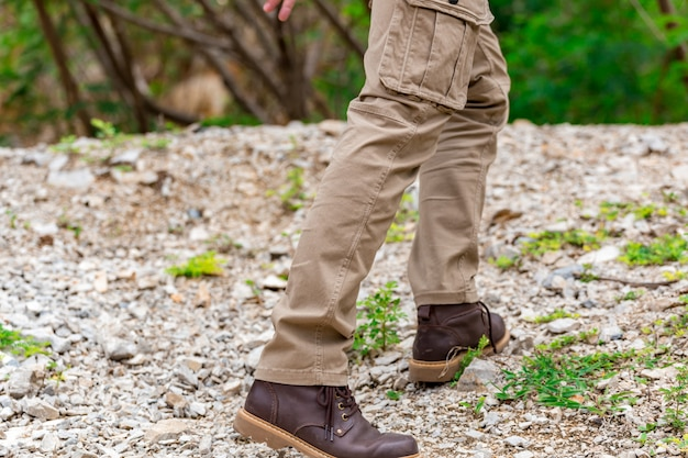 Man wearing cargo pants and climbing on the rock