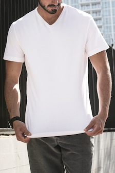 Man wearing casual white t-shirt in the city apparel shoot