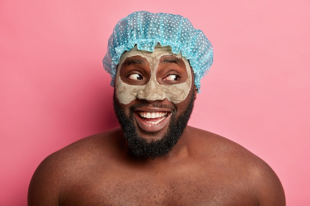 Man wearing cosmetic mask on face for dermatology skincare