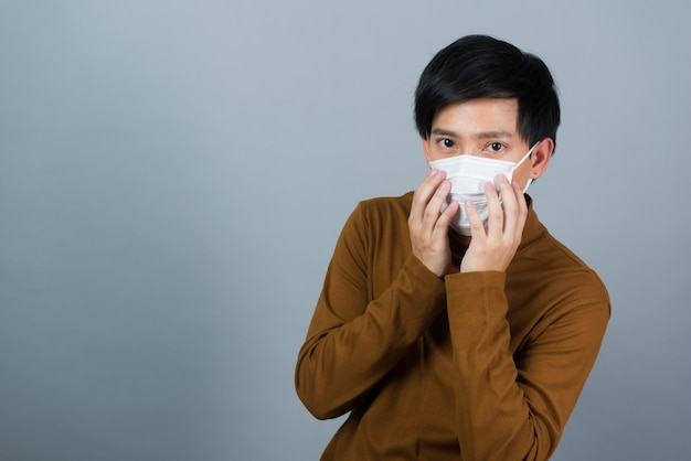 Man wearing dust mask, afraid of catching a cold, pm 2.5 dust