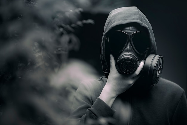 A man wearing a gas mask  and the gloomy atmosphere
