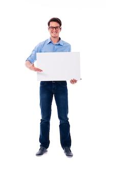 Man wearing glasses holding white board