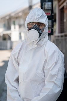 Man wearing gloves with biohazard chemical protective suit and mask.with unhappy face.