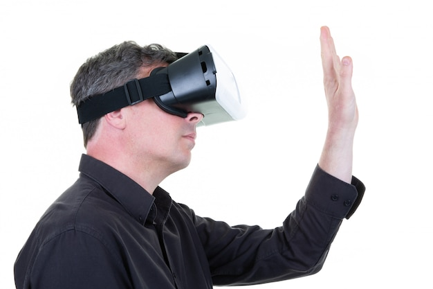 Man wearing goggle headset virtual reality world vr concept tech