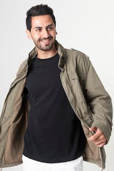 Man wearing green waxed cotton jacket portrait fashion shoot