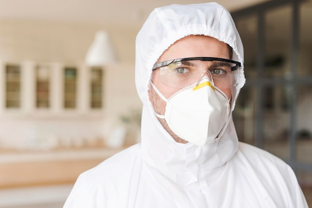 Man wearing hazmat suit and mask