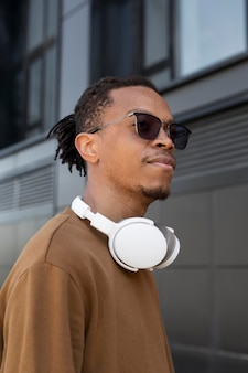 Man wearing headphones medium shot
