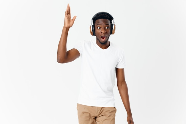 Man wearing headphones surprised facial expression music lifestyle