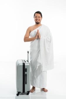 Man wearing ihram muslim clothes for hajj and umrah