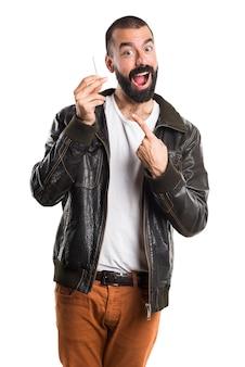 Man wearing a leather jacket smoking