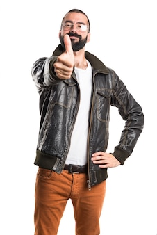 Man wearing a leather jacket with thumb up