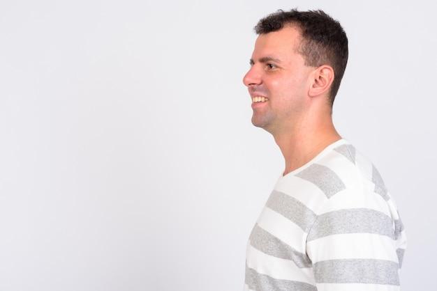 Man wearing long sleeved shirt on white