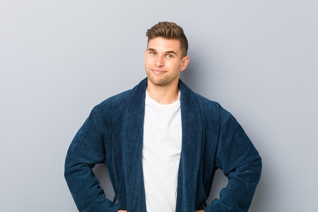 Man wearing pajama confident keeping hands on hips
