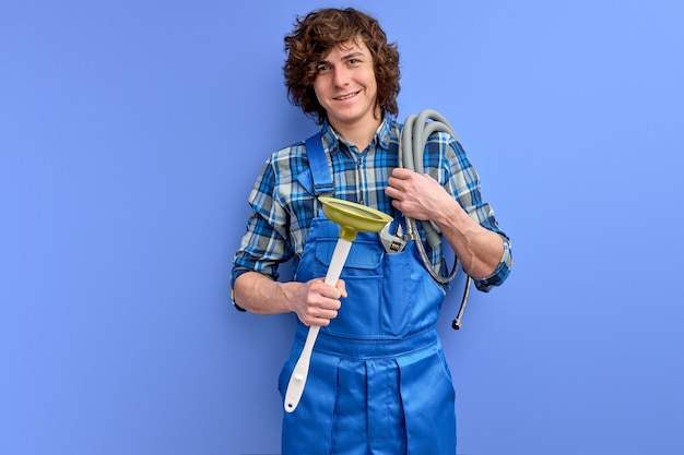 Man wearing plumber uniform holding toilet plunger celebrating achievement with happy smile