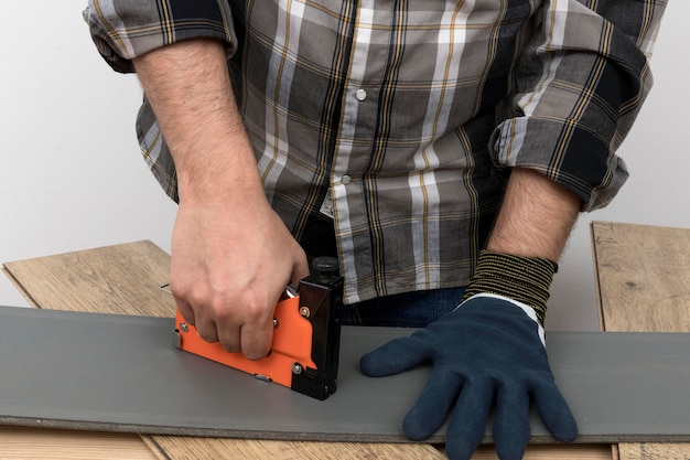 Man wearing protection gloves carpentry workshop concept