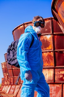 Man wearing protective suit, mask and goggles