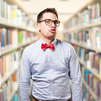 Man wearing a red bow tie. looking funny.