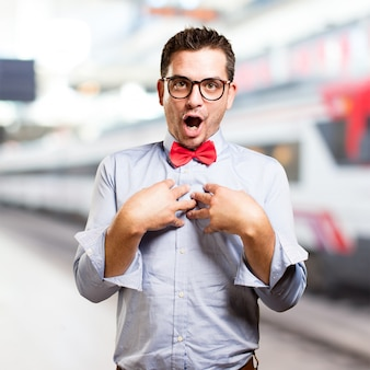 Man wearing a red bow tie. looking surprised.