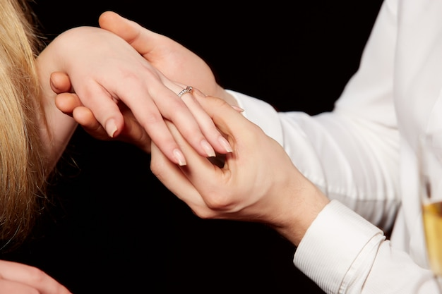 Man wearing ring to woman