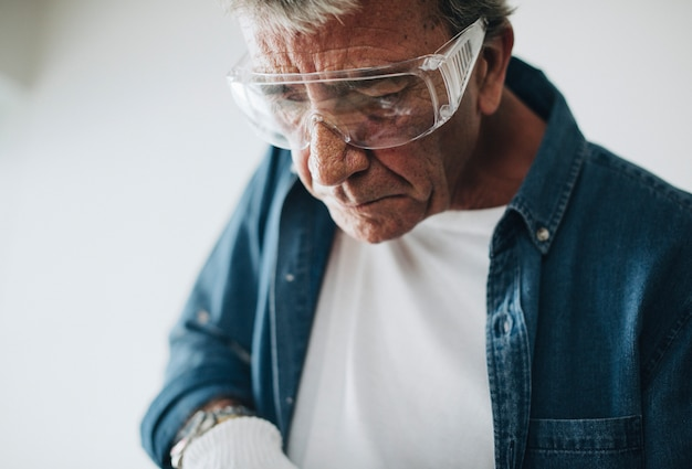 Man wearing safety glasses while renovating the house