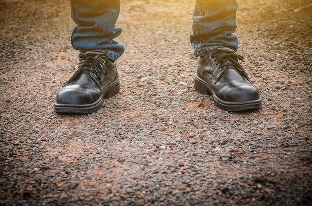 Man wearing safety shoes black color standing on the ground
