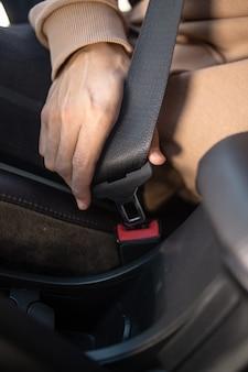 A man wearing a seat belt in a car close-up