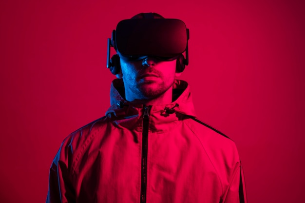Man wearing virtual reality gadget with red light