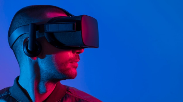 Man wearing vr glasses with blue light