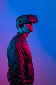 Man wearing vr glasses  with blue and purple light